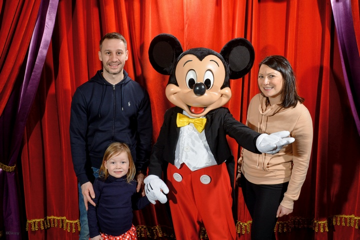 Family at Disneyland Paris with Mickey Mouse