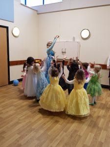 All of the princesses play with Princess Elsa.