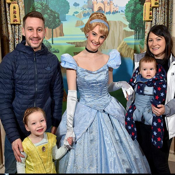 Family posing with Cinderella at Disneyland Paris