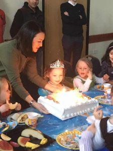 Sofia with her huge Costco birthday cake!