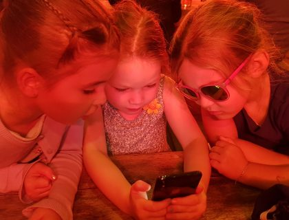 children looking at mobile phone