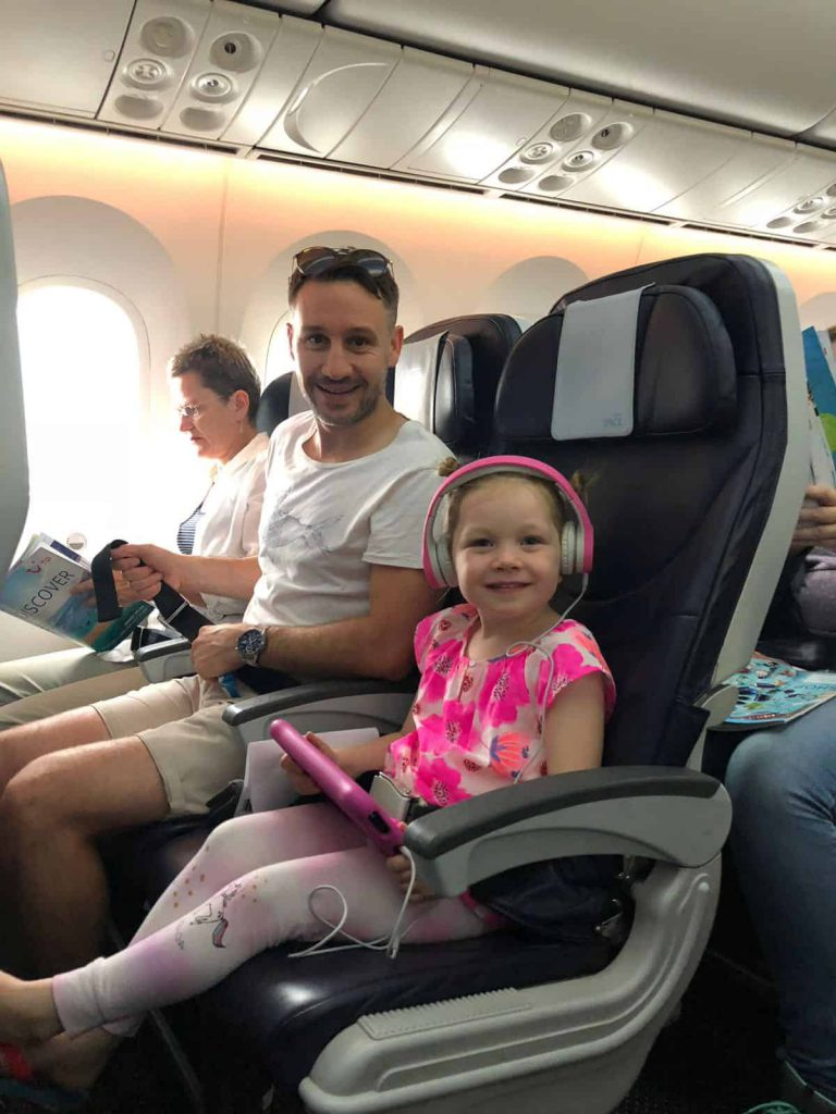 father and daughter on plane