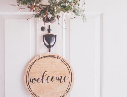 welcome sign on door of home