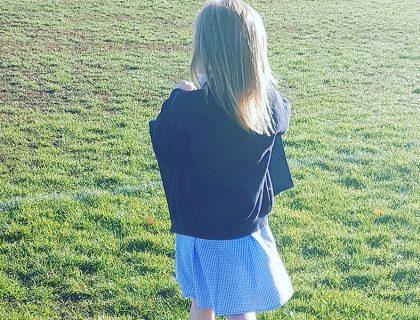 school girl walking to school