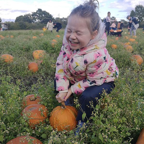 girl picking pumpkins