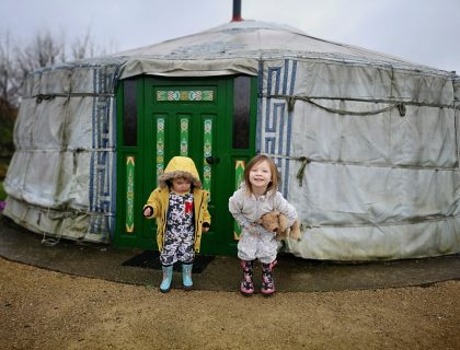 Two children outside a yurt