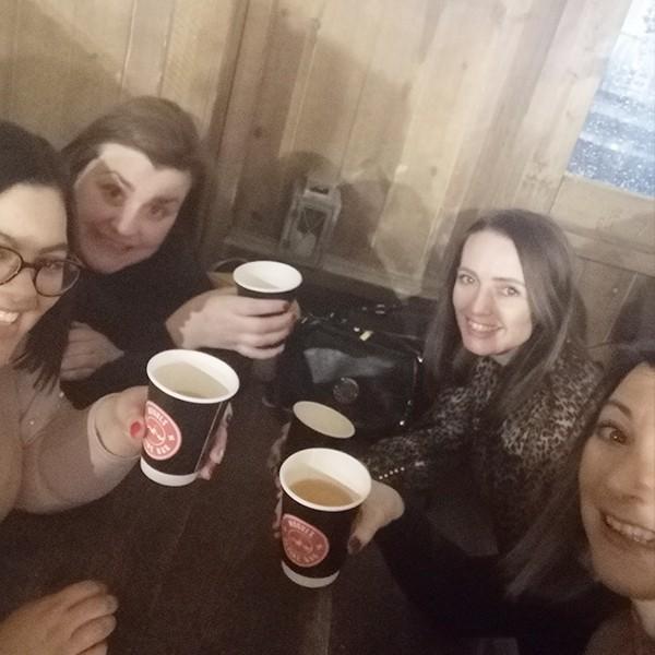 Four girls enjoying drinks