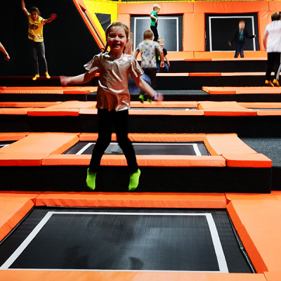 Young girl bouncing on trampoline