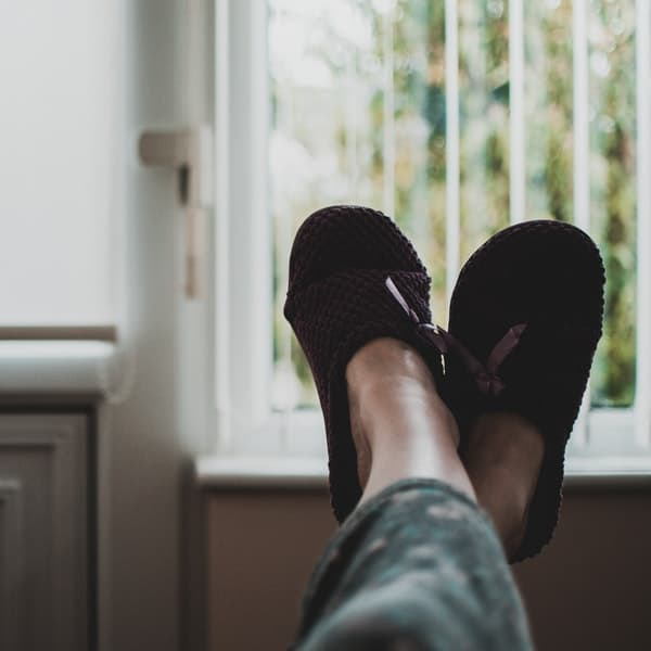 person relaxing in slippers