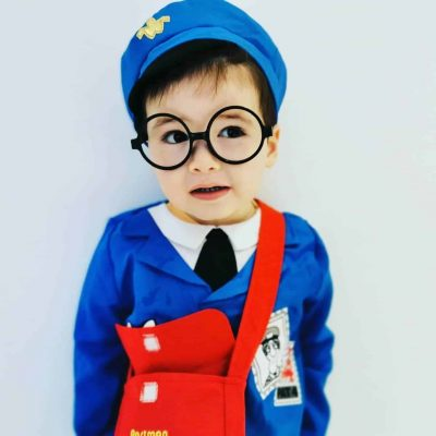 boy dressed as postman pat