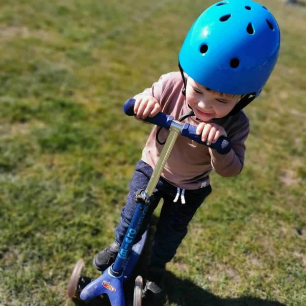 young boy on micro scooter