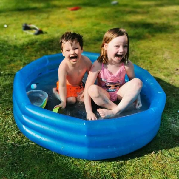children in a paddling pool