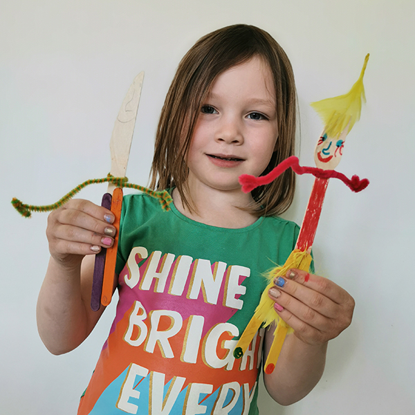 young girl with craft makes