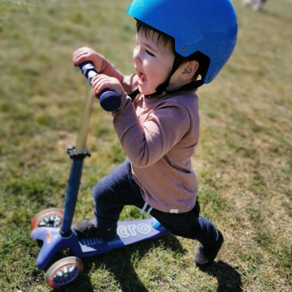 young boy on scooter