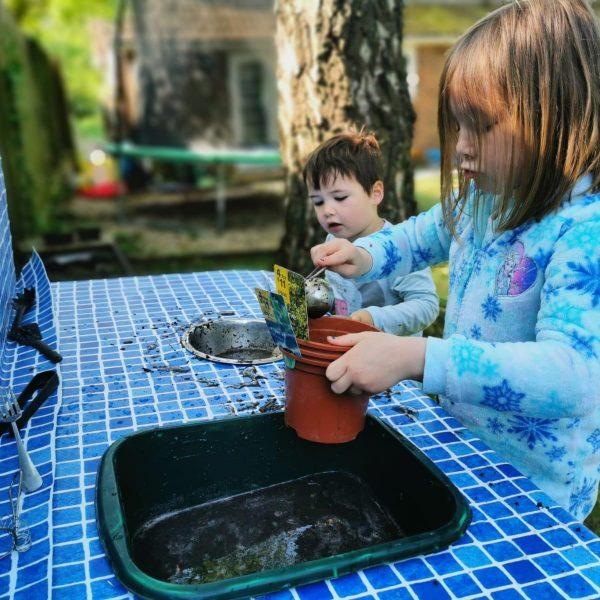 Children playing at mud kitchen