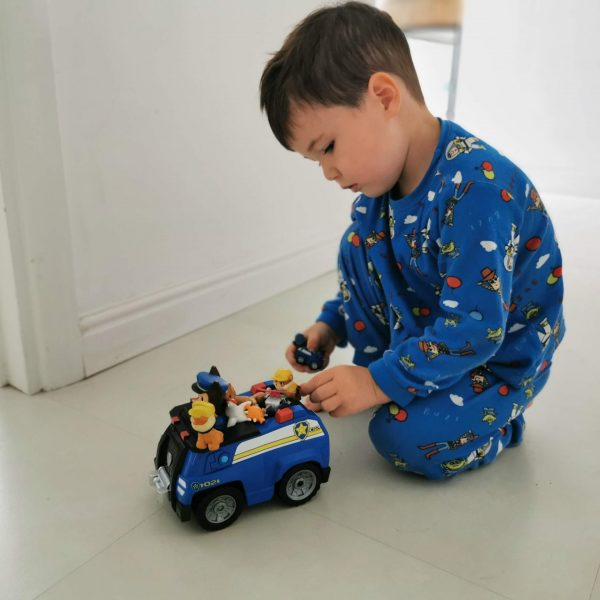 Young Boy playing with Paw Patrol toy