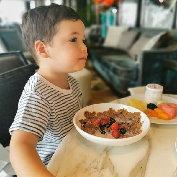 boy eating breakfast in a restaurant