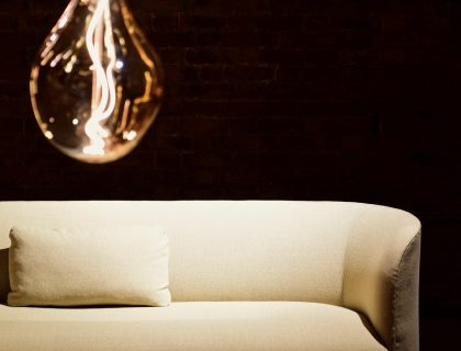 cream sofa with lighbulb in forefront