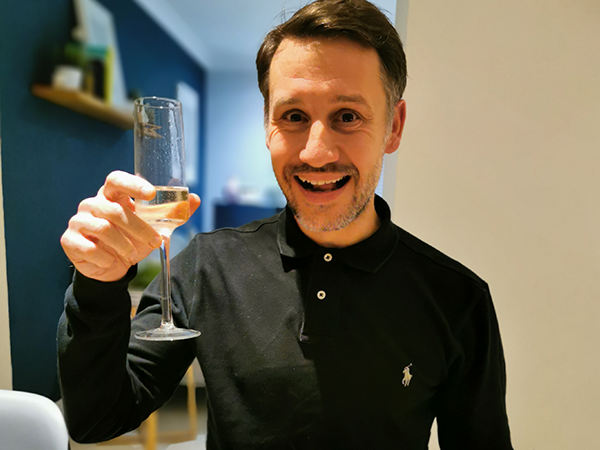 man with champagne glass