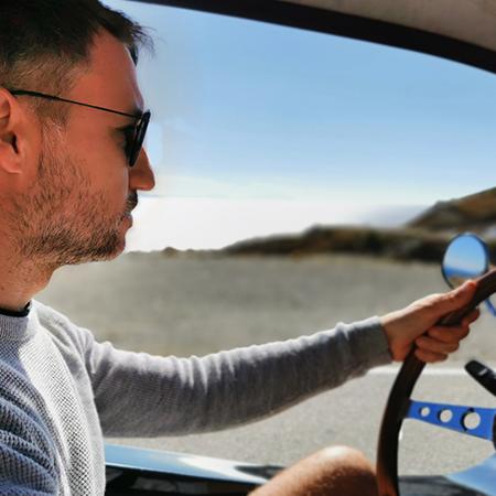 man driving a beach buggy