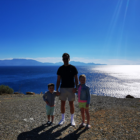 father and two young children at therma beach