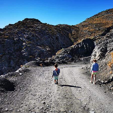 two children walking down mountain side