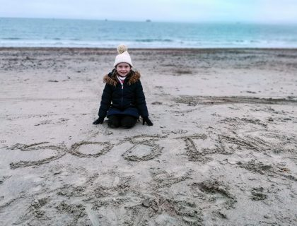 young girl on beach in winter