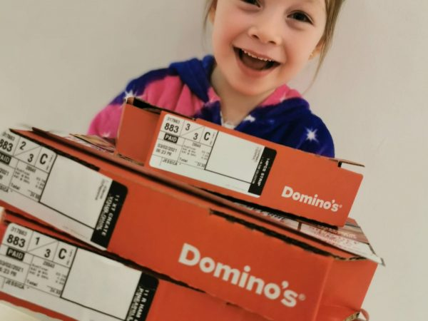 seven year old girl with dominos pizza boxes
